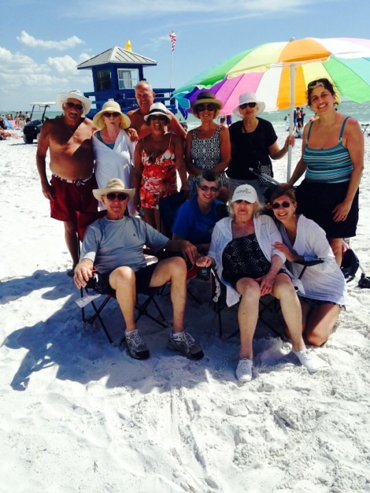 Mom, front and center, white cap, at the beach