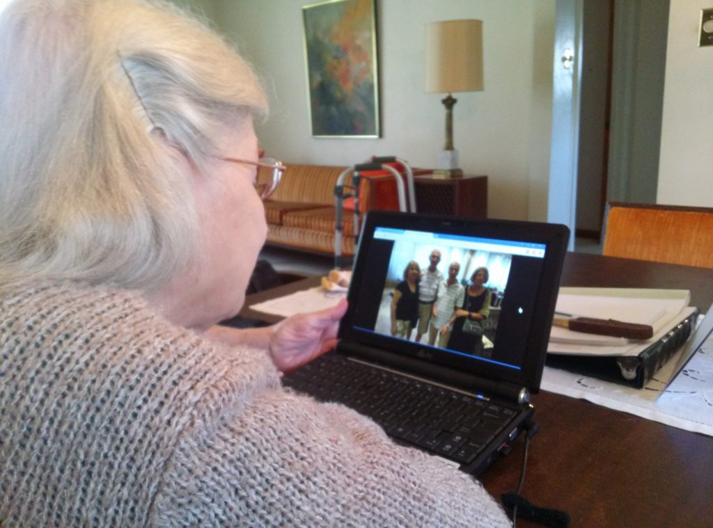 Mom looking at pictures of her brother's recent trip to Greece